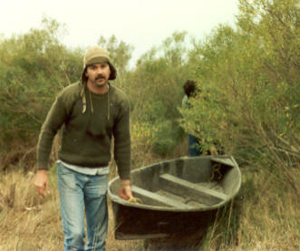 Joe's younger brother Buck pulling a pirogue.