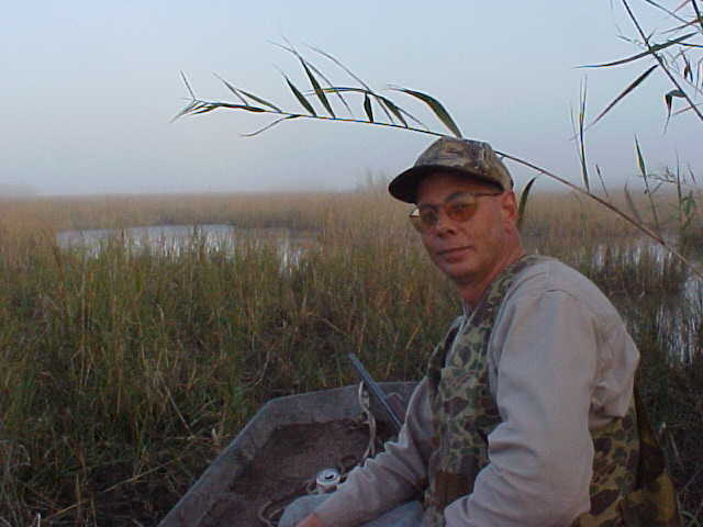 Me, relaxing in the marsh as the fog starts to roll in.