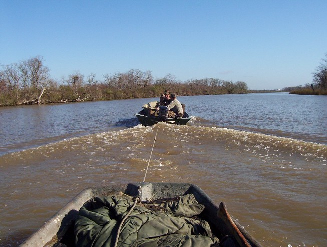 Being towed back to the launch Sunday morning after the mud boat overheated.