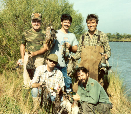 You didn't think Joe & Dick killed all those ducks in the previous picture all by themselves did you? That would be illegal! Actually, we had a large group for this hunt including top row left to right Russell, Randy and Paul. Joe and me on the bottom row. Dick took the picture. This picture was taken early in my duck hunting days. I don't recall the exact year, but it must have been in the late 80's when ducks were more plentiful in our area. The saltwater intrusion into the marshes near the mouth of the Mississippi River has killed much of the duck habitat in the area where we hunt resulting in fewer ducks taken in the past few years.