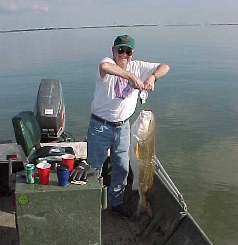 "Dick Pecot and his 38 lb. redfish.  This is a new ""official"" Pecot clan record for a red drum."