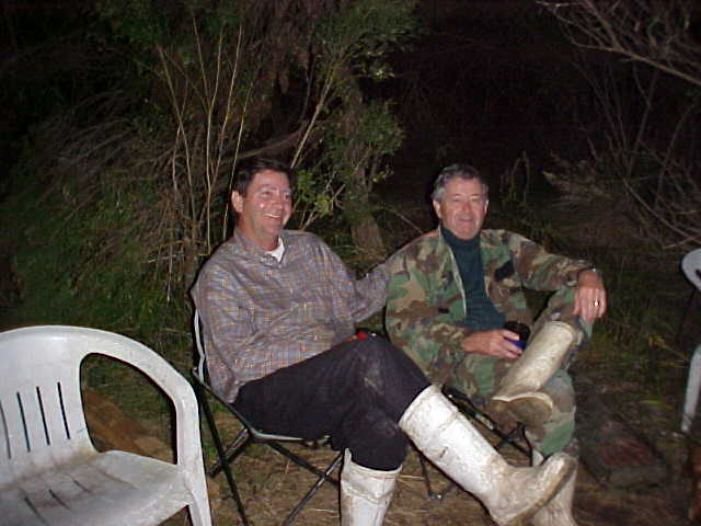 Joe and Dick relaxing at the camp site.